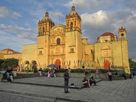 The Templo de Santo Domingo de Guzman lit up by sunset in Oaxaca City, Mexico.