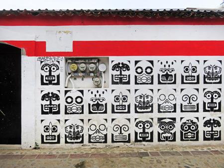 A skull-festooned wall in Oaxaca City, Mexico.