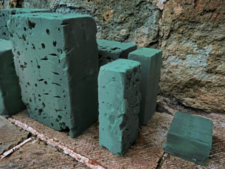 This green city rains down on me. Blocks of foam at rest in Oaxaca City, Mexico.
