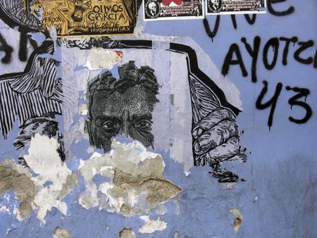 Tattered street art on a wall in Oaxaca City, Mexico.