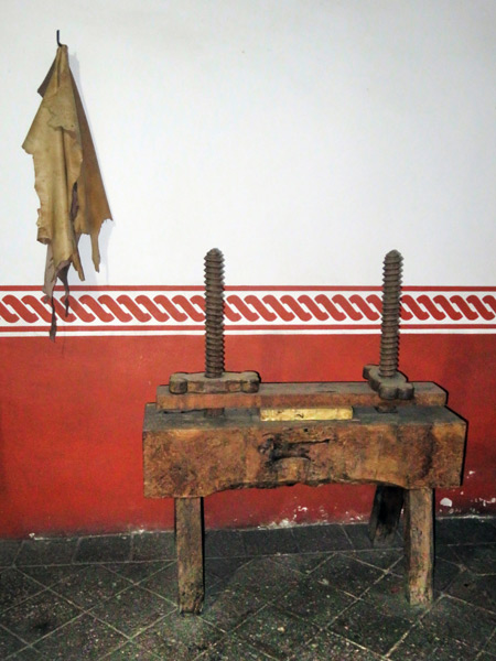 A vintage bookbinding press at Casa de Juarez in Oaxaca City, Mexico.