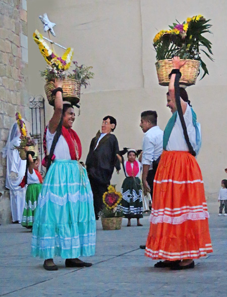 Traditional Oaxacan dancers prepare to perform at a wedding in Oaxaca City, Mexico.