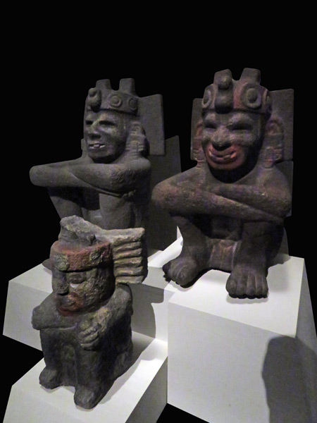 Three Aztec statues sit at the Museo Templo Mayor in Mexico City, Mexico.