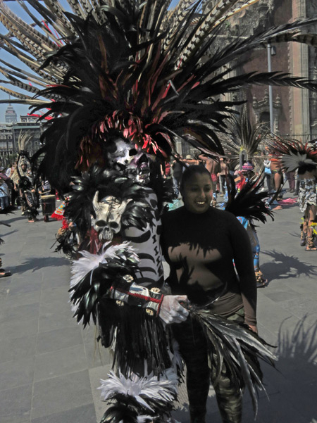 An Aztec dancer poses with a fan at the Zocalo in Mexico City, Mexico.