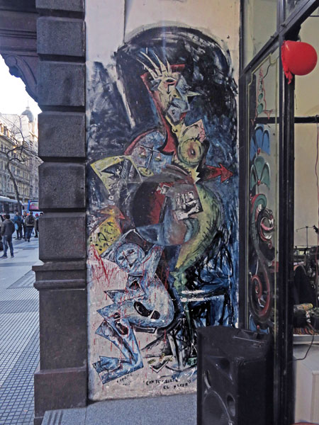 A mural in front of a shop on Avenue de Mayo in Buenos Aires, Argentina.