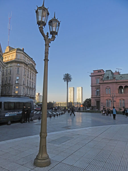 A palm tree echoes a light pole at the Plaza de Mayo in Buenos Aires, Argentina.