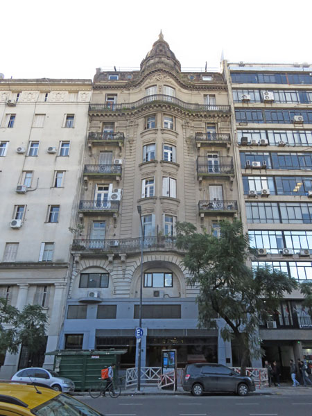 Which building is not like the others? Avenue Belgrano in Buenos Aires, Argentina.