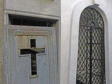 A door ajar on a crypt at the Cementerio de la Recoleta in Buenos Aires, Argentina.