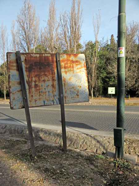 Pole Position with a rusty sign in Parque General San Martin, Mendoza, Argentina.