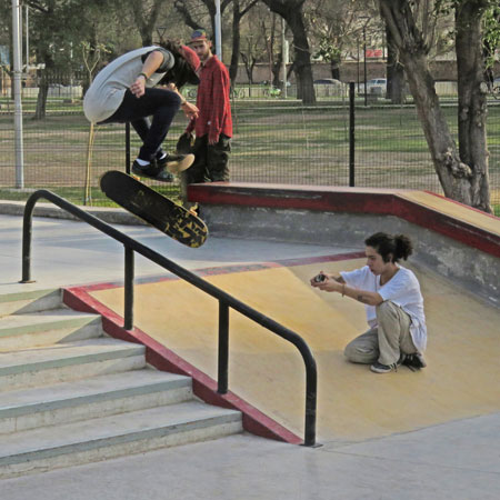 A local rips a flip trick down the stairs in the skatepark at Parque O'Higgins in Mendoza, Argentina.