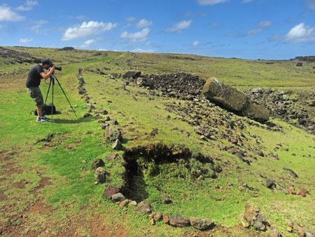Charlie photographs a toppled Moai at Vaihu, Rapa Nui, Chile.