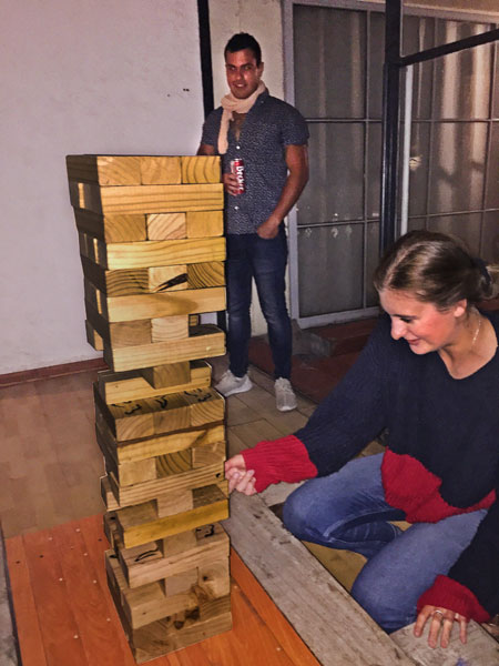 Playing Jenga at the Hostel Plaza de Armas in Santiago, Chile.