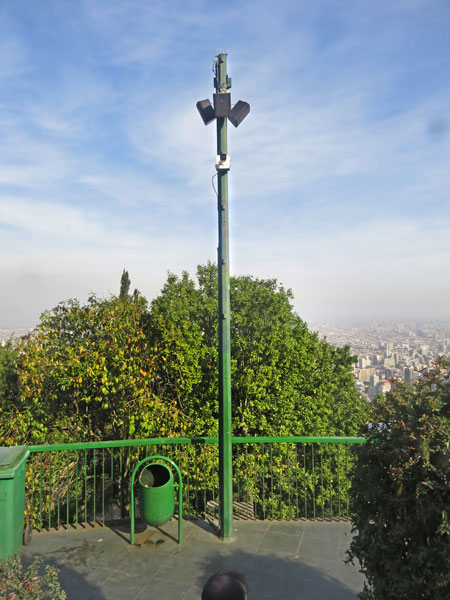 Pole position with audio and surveillance next to the statue of the Virgin Mary on top of Cerro San Cristobal in Santiago, Chile.