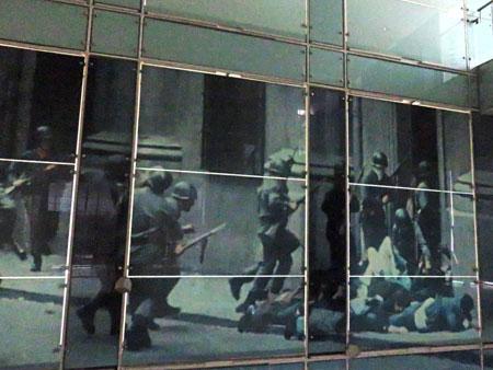 A large mural depicting the actions of Augusto Pinochet's 1973-1990 military dictatorship in Chile at the Museo de la Memoria y Los Derechos Humanas in Yungay, Santiago, Chile.
