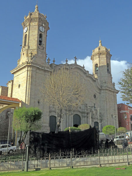 The lovely Catedral Metropolitana del Apóstol Santiago with an ugly black tarp in front of it in Potosi, Bolivia.