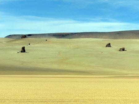 Rocks cast shadows at the Desierto Salvador Dali in the Reserva Nacional de Fauna Andina Eduardo Avaroa, Bolivia.