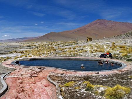 The hot springs pool at Polques Aguas Terminales in the Reserva Nacional de Fauna Andina Eduardo Avaroa, Bolivia.