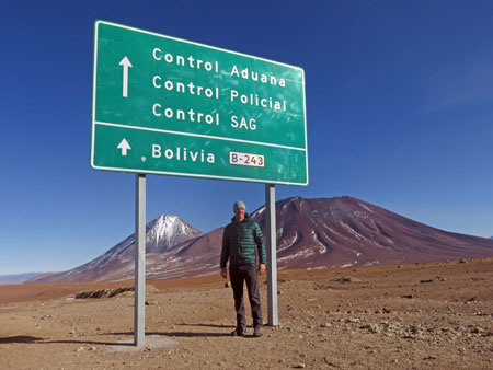 Scott stands at the Hito Cajon border crossing between Chile and Bolvia.