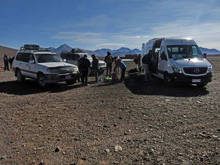 Transferring our luggage from the Cruz Andina van to two Toyota Land Cruisers at the Hito Cajon border crossing between Chile and Bolivia.