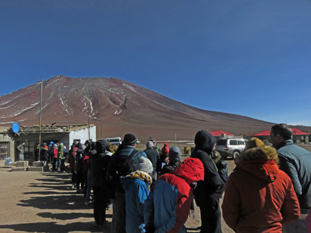 A long line in freezing cold wind at the Hito Cajon border crossing between Chile and Bolvia.