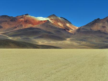 The vibrant brown, orange and red hues of the mountains at the Desierto Salvador Dali in the Reserva Nacional de Fauna Andina Eduardo Avaroa, Bolivia.