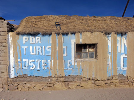 Some partially obscured lettering on a shop in Markuu Villa Mar, Bolivia.