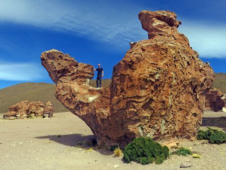 Scott strikes a pose on the camel rock at the Valle de Rocas in the Reserva Nacional de Fauna Andina Eduardo Avaroa, Bolivia.