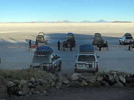 Cars parked at Isla Incahuasi on the Salar de Uyuni, Bolivia.