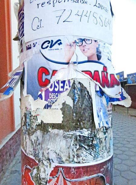 Torn flyers on a pole in Uyuni, Bolivia.