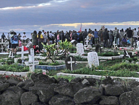 A funeral at the cemetery in Hanga Roa, Rapa Nui, Chile.