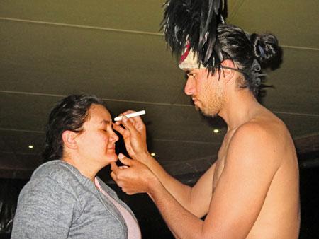 Face painting gets underway before the Puku Rangi Tea show at Pea Resto Bar in Hanga Roa, Rapa Nui, Chile.