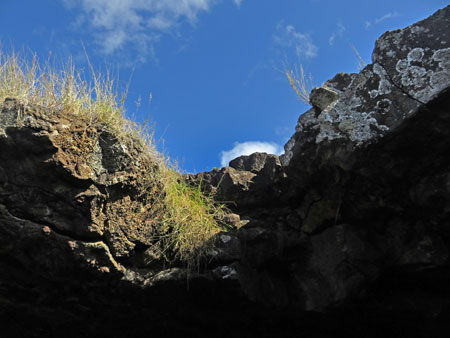 The edge of a natural skylight at Ana Te Pahu, Rapa Nui, Chile.