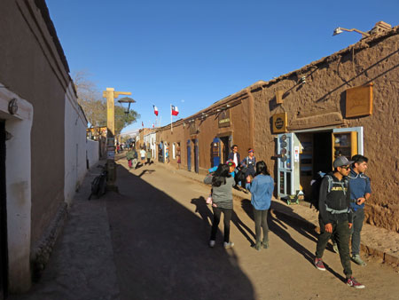 Pedestrians and shops in San Pedro de Atacama, Chile.