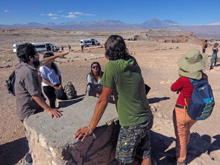 On the far left, the Lithium Aventura tour guide Alan points out some geologic features in the Valle de la Luna near San Pedro de Atacama, Chile.