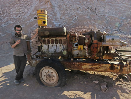 The Lithium Aventura tour guide Alan relaxes with his friend Mr. Contraption in the Valle de la Luna near San Pedro de Atacama, Chile.