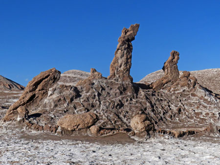 The praying rocks, left to right: crouched, standing and kneeling in the Valle de la Luna near San Pedro de Atacama, Chile.