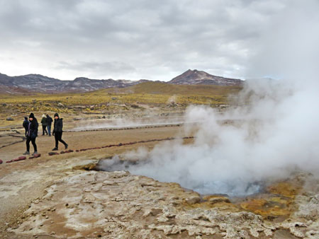 A steaming geyser at El Tatio geyser field, Andes Mountains, Chile.