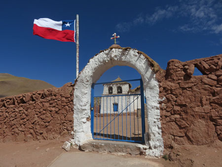 The gate in front of a tiny church in the village of Machuca in the Andes Mountains, Chile.