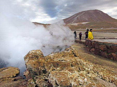 Some more guys and a geyser at El Tatio geyser field, Andes Mountains, Chile.
