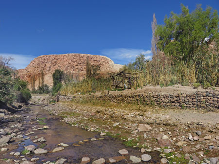 A creek and rock formation in the Jerez Valley, Chile.