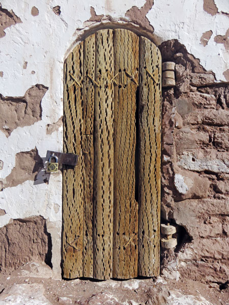A rustic door on the bell tower in Toconao, Chile.