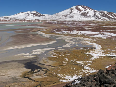 Mountains and a muted psychedelic lake at Piedras Rohas, Chile.