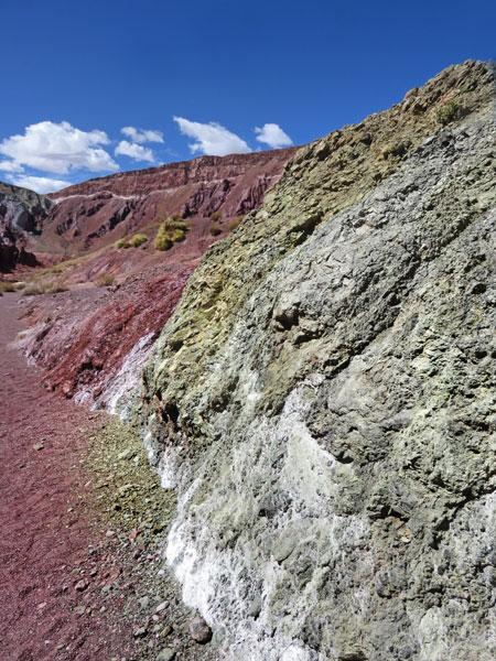 Rough hewn red and green slabs in the Valle de Arcoiris, near San Pedro de Atacama, Chile.