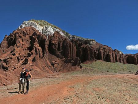 Tourists pose in front of rainbow-hued rocks in the Valle de Arcoiris, near San Pedro de Atacama, Chile.