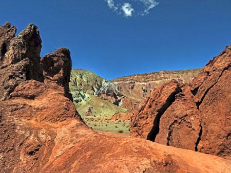 Spectacular green and orange rock formations in the Valle de Arcoiris, near San Pedro de Atacama, Chile.