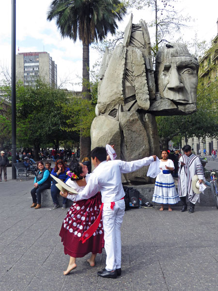 Another young couple performs a traditional Cueca dance at the Plaza de Armas in Santiago, Chile.