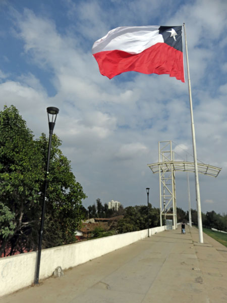 The flag of Chile flies over Parque O'Higgins in Santiago, Chile.