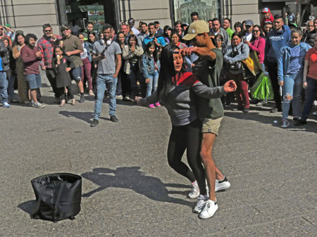 Another couple dances to a percussion band at the Plaza de Armas in Santiago, Chile.