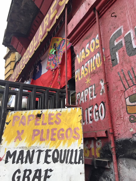 Hand-painted signs in Santiago, Chile.