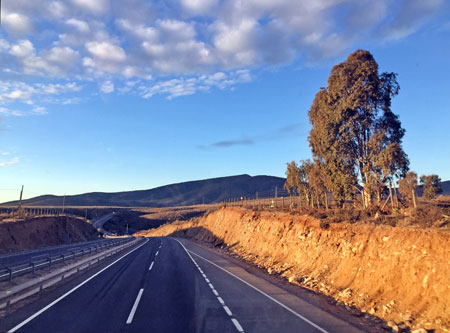 On the road at sunset from Santiago to San Pedro de Atacama, Chile.